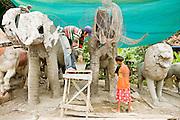 03 JULY 2006 - PHNOM PENH, CAMBODIA: Artisans make lawn sculptures (lions and elephants) at a shop in Koky near Phnom Penh, Cambodia.  PHOTO BY JACK KURTZ