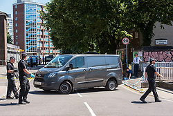 © Licensed to London News Pictures.  25/06/2018; Bristol, UK. A private ambulance arrives to remove a deceased man. A murder investigation has been launched after a man dies and two are seriously injured in an armed burglary in Prewett Street, Redcliffe, in the early hours of the morning. It is reported that neighbours have told of hearing bloodcurdling screams of as three men were attacked with a sword-like knife. Two other men who suffered life-threatening injuries have been taken to hospital. It is reported that two men from London have been arrested in connection with the incident. Photo credit: Simon Chapman/LNP