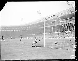 England goalkeeper Gordon Banks pushes a shot around the post