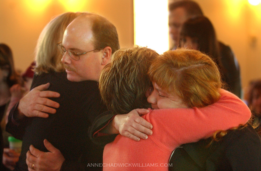 John and Alicia Bennett are hugged by friends who attended the funeral of their son, Tommy, 4, Tuesday. Tommy died last week while undergoing treatment for Sanfilippo syndrome at Duke University in Durham, North Carolina. About 120 people attended the service at Ione community United Methodist Church in Ione, CA. Tommy's two siblings also have the rare genetic disease. December 2, 2003..