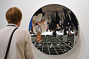 HONG KONG - MARCH 13: A visitor looks at his own reflection in the steel sculpture 'Untitled, 2015' by Anish Kapoor, on the preview day of Art Basel on March 13, 2015 in Hong Kong, Hong Kong.  (Photo by Lucas Schifres/Getty Images)