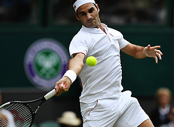 July 4, 2018 - London, England, United Kingdom - Roger Federer of Switzerland hits a return during the men's singles second round match against Lukas Lacko of Slovakia at the Wimbledon Tennis Championships in London, Britain on July 4, 2018. Federer won 3-0. (Credit Image: © Guo Qiuda/Xinhua via ZUMA Wire)