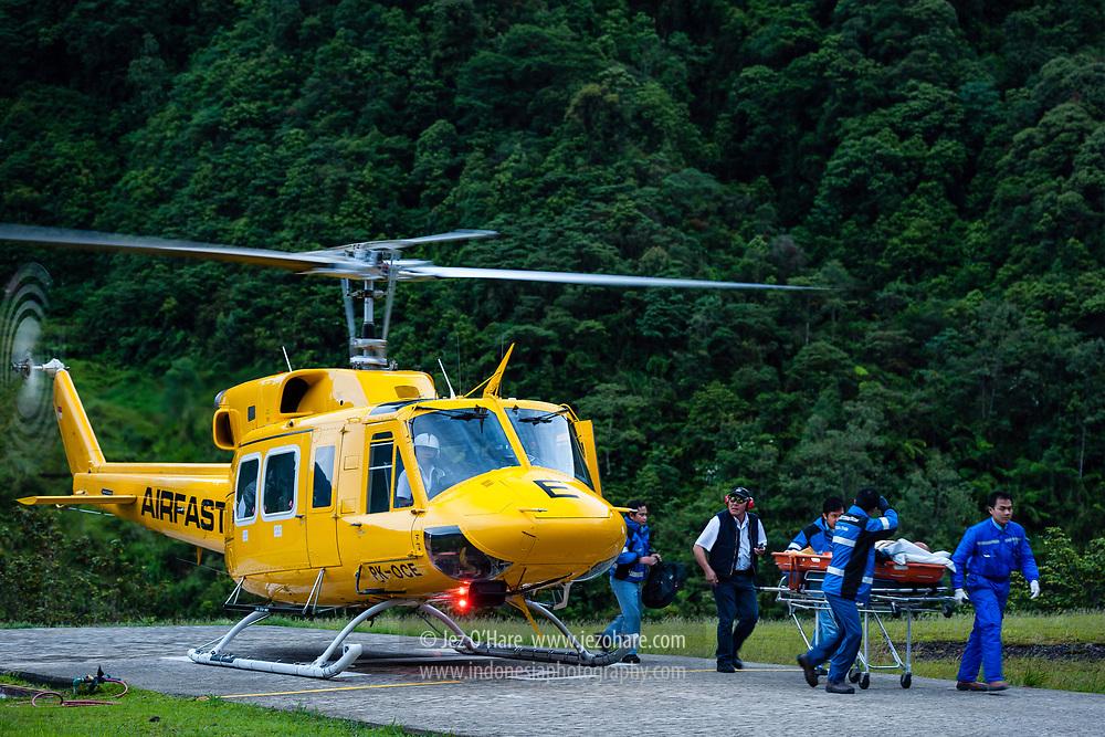 Capt. Bambang Pratiknyo in a PT Freeport Bell 212 helicopter during medivac at Tembagapura helipad, Mimika, Papua, Indonesia.