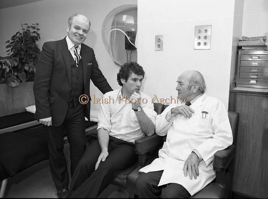 Tony Ward Gives Blood..1984.16.03.1984.03.16.1984.16th March 1984..With a possible shortage of blood over the St Patrick's Weekend,Tony Ward,Irish Rugby International,led an awareness campaign by donating blood. He attended The Blood Transfusion Service,Pelican House,Mespil Road,Dublin...The Director and the Doctor in Charge discuss with Tony the importance of blood Donation..If you can name the individuals in this picture, why not contact us at irishphotoarchive@gmail.com