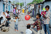 A boy is playing with a red balloon on the streets of New Arif Nagar, one of the water-affected colonies standing next to the abandoned Union Carbide (now DOW Chemical) industrial complex, site of the infamous 1984 gas tragedy in Bhopal, Madhya Pradesh, central India. The poisonous cloud that enveloped Bhopal left everlasting consequences that today continue to consume people's lives.