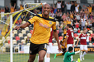 Chris Zebroski of Newport county celebrates after scoring his side's first goal. Skybet football league two match, Newport county v Northampton Town at Rodney Parade in Newport, South Wales on Saturday13th Sept 2014<br /> pic by Mark Hawkins, Andrew Orchard sports photography.