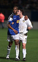 Fotball, Leeds United's hero Robbie Keane kisses team-mate Michael Duberry at the final whistle.