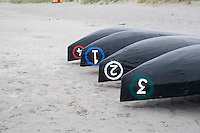 Currach Boats overturned on the beach on Inis Oirr on the Aran Islands Galway Ireland