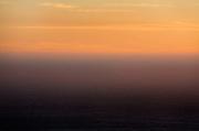 Sun sets over pacific ocean in California