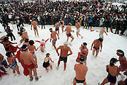 Snow baths at the Winter Carnival. Quebec, Canada.