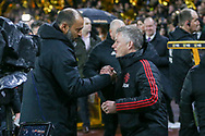 Wolverhampton Wanderers manager Nuno Espirito Santo greets Manchester United interim Manager Ole Gunnar Solskjaer during the The FA Cup match between Wolverhampton Wanderers and Manchester United at Molineux, Wolverhampton, England on 16 March 2019.