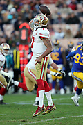 San Francisco 49ers quarterback Colin Kaepernick (7) jumps and throws a pass during the 2016 NFL week 16 regular season football game against the Los Angeles Rams on Saturday, Dec. 24, 2016 in Los Angeles. The 49ers won the game 22-21. (©Paul Anthony Spinelli)