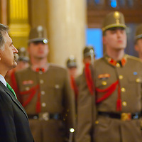 Laszlo Kover (L) speaker of the house inspects the guard of honor before the new members of the Guard of the Crown take an oath in the Hungarian Parliament in Budapest, Hungary on September 20, 2011. ATTILA VOLGYI