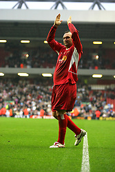 LIVERPOOL, ENGLAND - SUNDAY MARCH 27th 2005: Liverpool Legends' Neil Ruddock applauds the Kop after the Tsunami Soccer Aid match at Anfield. (Pic by David Rawcliffe/Propaganda)