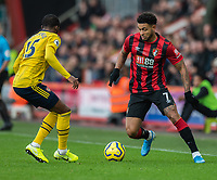 Arsenal's Ainsley Maitland-Niles (left) vies for possession with Bournemouth's Joshua King (right) <br /> <br /> Photographer David Horton/CameraSport<br /> <br /> The Premier League - Bournemouth v Arsenal - Thursday 26th December 2019 - Vitality Stadium - Bournemouth<br /> <br /> World Copyright © 2019 CameraSport. All rights reserved. 43 Linden Ave. Countesthorpe. Leicester. England. LE8 5PG - Tel: +44 (0) 116 277 4147 - admin@camerasport.com - www.camerasport.com