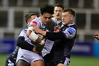 Rugby Union - 2020 / 2021 Gallagher Premiership - Newcastle Falcons vs Sale - Kingston Park<br /> <br /> Denny Solomona of Sale Sharks is tackled by Brett Connon of Newcastle Falcons and Ben Stevenson of Newcastle Falcons<br /> <br /> COLORSPORT/BRUCE WHITE