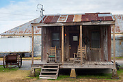 Guest shacks hotel rooms at The Shack Up Inn cotton sharecroppers theme hotel in Clarksdale, Blues birthplace, Mississippi, USA