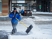 11 NOVEMBERS 2019 - DES MOINES, IOWA: A city worker clears snow from a sidewalk in downtown Des Moines Monday morning. About three inches of snow fell in the Des Moines area Sunday night into Monday morning snarling the Monday morning rush hour and delaying central Iowa schools by about two hours.       PHOTO BY JACK KURTZ