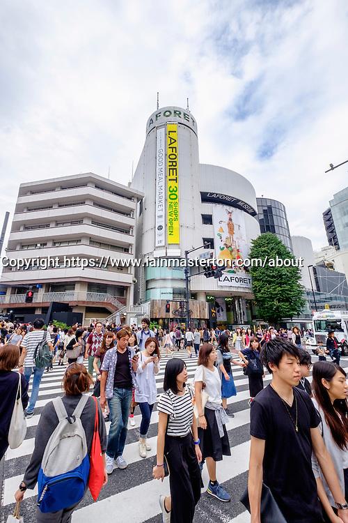 Busy pedestrian crossing at Omotesando in Tokyo Japan