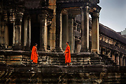 "The ""lost city"" of Angkor first attracted the interest of Europeans in the 1800s after Cambodia was colonized by the French. Today, Angkor Wat continues to draw thousands of visitors anxious to see this remarkable ancient temple in the jungle.<br /> In addition to many tourists, Buddhist monks are daily visitors to Angkor Wat, their bright orange robes making a vivid contrast with the grey stone of the temple."