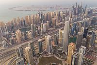 Aerial panoramic view of Dubai skyscrapers and Palm Jumeirah, UAE.