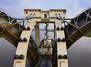 Nederland, Gelderland, Gemeente Overbetuwe, 04-002-2021; Hoog water bij de stuw bij Driel in de Neder-rijn. In verband met het hoge water ten gevolge van overvloedige regenval en smeltwater bij de bovenloop van de rivier de Rijn, heeft ook de benedenloop - de Nederrijn - met hoge waterstanden te maken. Daarom is de vizierschuif van de stuw is geopend. De stuw bij Driel, de Kraan van Nederland, zorgt voor afvoer van het water van de Rijn via Nederrijn en Lek.<br /> High water at the weir at Driel in the Lower Rhine. Due to high waters caused by abundant rainfall and meltwater at the upper coures of the river Rhine, the Lower Rhine also has to deal with high water levels. Therefore, the visor slide of the weir has been opened. The weir at Driel, the Kraan van Nederland, provides drainage of the water from the Rhine via Nederrijn and Lek.<br /> drone-opname (luchtopname, toeslag op standaard tarieven);<br /> drone recording (aerial, additional fee required);<br /> copyright foto/photo Siebe Swart