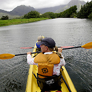 KAUAI, HI, July 14, 2007: A mother and her son kayak the Hanalei River en route to the Hanalei National Wildlife Refuge on the North Shore of Kauai (Photograph by Todd Bigelow/Aurora)