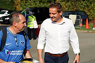 AFC Wimbledon manager Neal Ardley talking to Portsmouth fan during the EFL Sky Bet League 1 match between AFC Wimbledon and Portsmouth at the Cherry Red Records Stadium, Kingston, England on 13 October 2018.