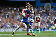 Matthew Lowton of Burnley intercepts Oscar of Chelsea.  Premier league match, Chelsea v Burnley at Stamford Bridge in London on Saturday 27th August 2016.<br /> pic by John Patrick Fletcher, Andrew Orchard sports photography.