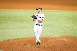 August 24, 2017 - St. Petersburg, Florida, U.S. - WILL VRAGOVIC       Times.Tampa Bay Rays relief pitcher Brad Boxberger (26) dodges the single by Toronto Blue Jays left fielder Ezequiel Carrera (3) in the seventh inning of the game between the Toronto Blue Jays and the Tampa Bay Rays at Tropicana Field in St. Petersburg, Fla. on Thursday, Aug. 24, 2017. (Credit Image: © Will Vragovic/Tampa Bay Times via ZUMA Wire)