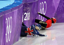 Great Britain's Elise Christie (left) crashes out in the Short Track Speed Skating - Ladies 1,500m Semifinal 3 after a collison with China's LI Jinyu (top) at the Gangneung Oval during day eight of the PyeongChang 2018 Winter Olympic Games in South Korea.