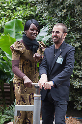 © Licensed to London News Pictures. 21/05/2012. London, England. Pumping water for WaterAid, Ringo Starr with WaterAid worker from Malawi. RHS Celsea Flower Show 2012 - Press Day. Photo credit: Bettina Strenske/LNP