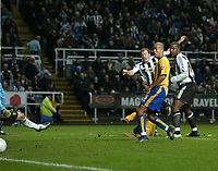 Photo: Andrew Unwin.<br />Newcastle United v Mansfield Town. The FA Cup.<br />07/01/2006.<br />Newcastle's Alan Shearer (L) fires home his 200th club goal.