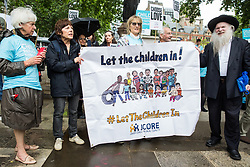 London, UK. 18 June, 2019. Campaigners with the Jewish Council for Racial Equality (JCORE) attend a demonstration in Parliament Square to demand that the Government resettle 10,000 unaccompanied refugee children over 10 years. As part of Lord Dubs' 'Our Turn' campaign, councils around the UK have already pledged places for over 1,100 children if the Government should make a new resettlement commitment.