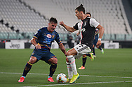 Juventus's Portuguese striker Cristiano Ronaldo is confronted by Lecce's Italian defender Giulio Donati during the Serie A match at Allianz Stadium, Turin. Picture date: 26th June 2020. Picture credit should read: Jonathan Moscrop/Sportimage