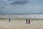 Local people on the beach at low tide near an Algae farm. East Coast, Zanzibar