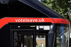 """© Licensed to London News Pictures. 18/07/2016. London, UK. The wording """"voteleave.uk still written on the side of the bus. A bus used by the Leave campaign during the EU referendum, rebranded by Greenpeace outside the Houses of Parliament in London. The """"Brexit Bus"""" was previously covered in a slogan claiming that £350 million sent to the EU could be spent on the NHS.  Photo credit: Peter Macdiarmid/LNP"""