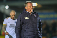 AFC Wimbledon manager Wally Downes walking off the pitch during the EFL Sky Bet League 1 match between AFC Wimbledon and Peterborough United at the Cherry Red Records Stadium, Kingston, England on 12 March 2019.
