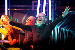 """© Licensed to London News Pictures . 05/02/2016 . Manchester , UK . DJ MIKE PICKERING . """" Hacienda Classical """" debut at the Bridgewater Hall . The 70 piece Manchester Camerata and performers including New Order's Peter Hook , Shaun Ryder , Rowetta Idah , Bez and Hacienda DJs Graeme Park and Mike Pickering mixing live compositions . Photo credit : Joel Goodman/LNP"""