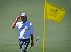 Fred Couples acknowledges the applause of the gallery as he walks onto the 2nd green during the third round of the Masters Tournament at Augusta National Golf Club in Augusta, Ga., on Saturday, April 8, 2017. (Photo by Jeff Siner/Charlotte Observer/TNS) *** Please Use Credit from Credit Field ***