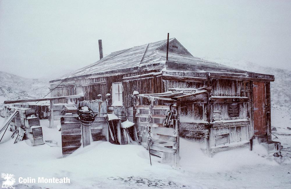 Shackleton's 190709 hut in a blizzard, Capre Royds, Ross Island, Antarctica.