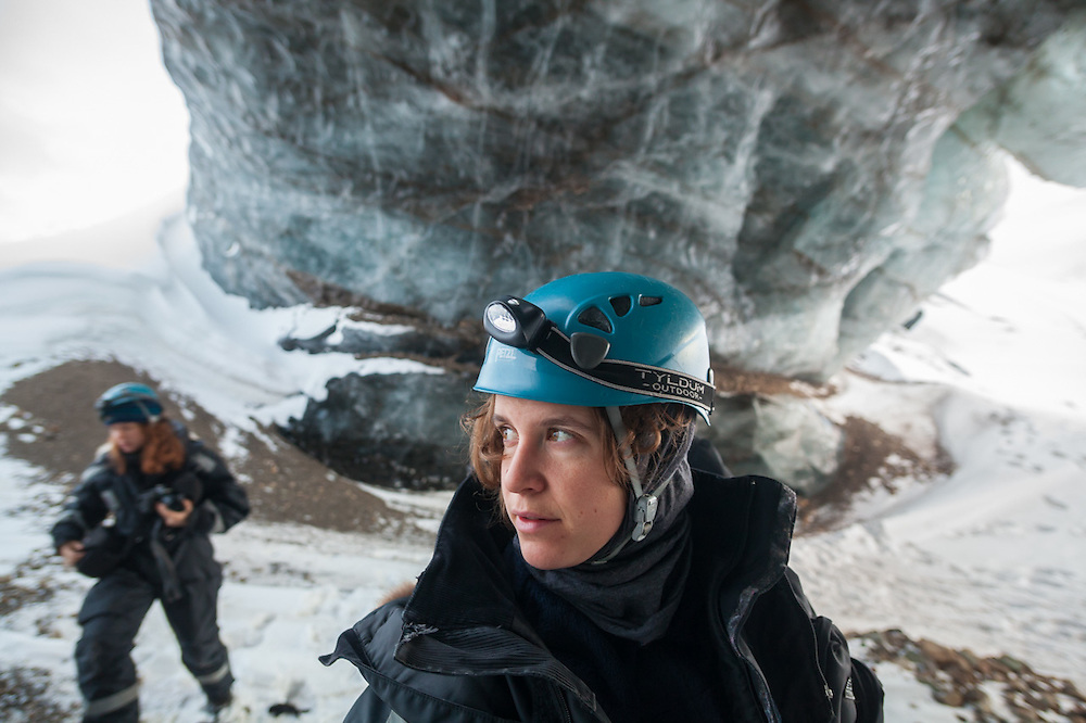 UNIS student Mylène Jacquemart under a large ice arch on a class field trip to Tellbreen, Svalbard.