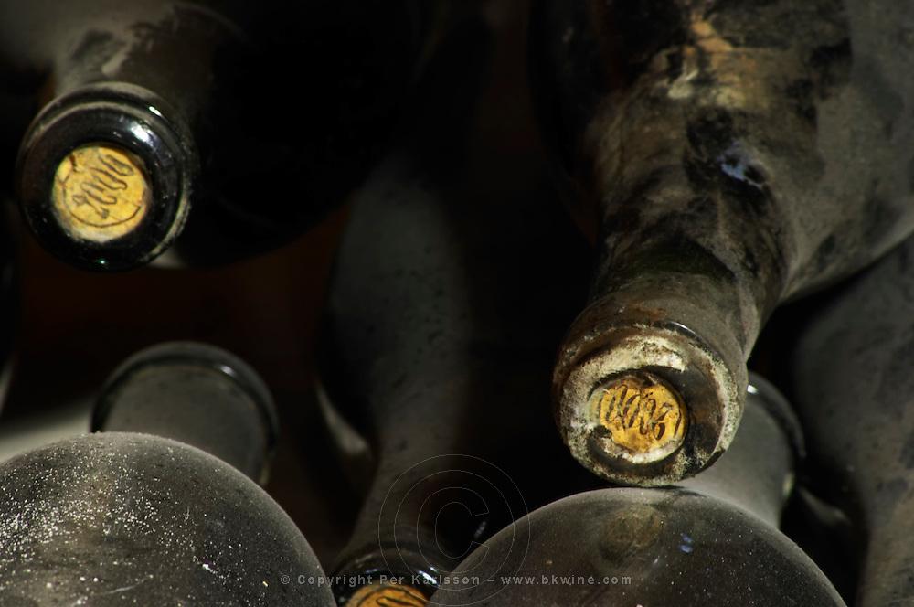 2000 stamped on the cork on old dusty bottles. Domaine Cazeneuve in Lauret. Pic St Loup. Languedoc. Bottle cellar. France. Europe. Bottle. Bins with bottles.