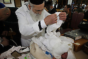 Circumcision - Brit Mila Ceremony The mohel at work
