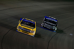 September 14, 2018 - Las Vegas, NV, U.S. - LAS VEGAS, NV - SEPTEMBER 14: Grant Enfinger (98) Champion Power Equipment, Curb Records Curb Racing Ford F-150 leads Noah Gragson (18) Safelite Auto Glass Kyle Busch Racing Toyota Tundra during the World of Westgate 200 NASCAR Camping World Truck Series Playoff Race on September 14, 2018, at Las Vegas Motor Speedway in Las Vegas, NV. (Photo by David Griffin/Icon Sportswire) (Credit Image: © David Griffin/Icon SMI via ZUMA Press)