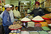 Nuts and dried fruits on sale at Khari Baoli spice and dried foods market, Old Delhi, India
