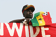 A supporter of the Ghana national football team sells hats and flags prior to a game between Ghana and Cameroon during the 2008 Africa Cup of Nations in Accra, Ghana on February 7, 2008.