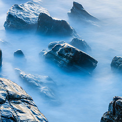 Rocks along on the coast at Wallis Sands State Park in Rye, New Hampshire.