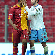 Galatasaray's Colin Kazim RICHARDS (L) and Trabzonspor's Remzi Giray KACAR (R) during their Turkish superleague soccer derby match Galatasaray between Trabzonspor at the TT Arena in Istanbul Turkey on Sunday, 10 April 2011. Photo by TURKPIX