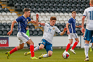 Russia's Kiril Schetinin goes to ground under the challenge of Andrew Winter (Hamilton Academical) during the U17 European Championships match between Scotland and Russia at Simple Digital Arena, Paisley, Scotland on 23 March 2019.